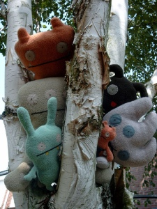 Ugly puppets in a tree